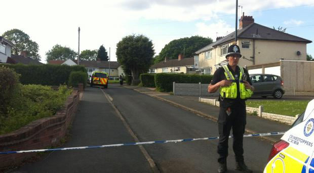 Police at Chells Grove in Billesley, Birmingham where a mother and her baby were found dead