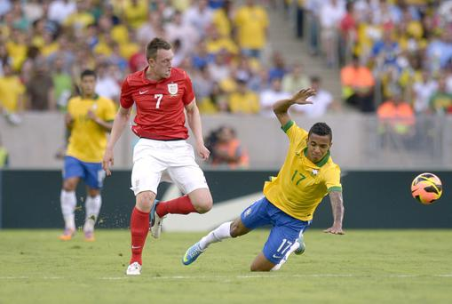 England's Phil Jones and Brazil's Luis Gustavo Dias (right) battle for the ball during the International Friendly at the Maracana Stadium in Rio De Janeiro, Brazil.