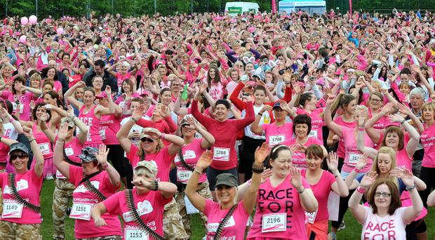 The almost 4000 strong crowd who turned up to take part in The Race For Life at Stormont on Sunday get armed up before the race