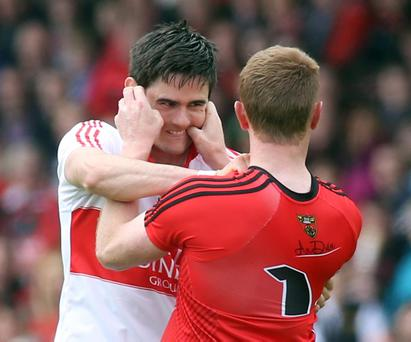 Derry's Chrissy McKaigue grapples with Down's Benny Coulter