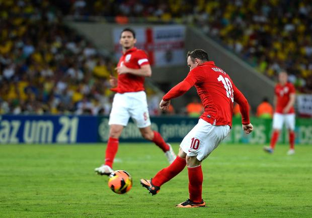 RIO DE JANEIRO, BRAZIL - JUNE 02: Wayne Rooney of England scores the second goal during the International Friendly match between England and Brazil at Maracana on June 2, 2013 in Rio de Janeiro, Brazil. (Photo by Laurence Griffiths/Getty Images)