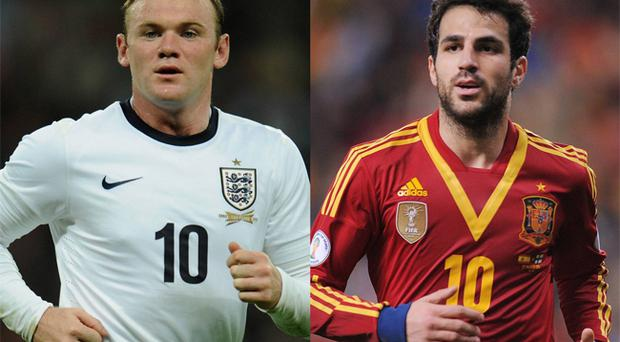 Wayne Rooney and Cesc Fabregas have both been mentioned by Arsenal manager Arsene Wenger