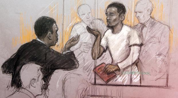 Court artist sketch of a member of the public gallery blowing kisses at Michael Adebolajo in the dock at Westminster Magistrates Court, where he is accused of murdering soldier Drummer Lee Rigby and of the attempted murder of two police officers and possession of a firearm, a 9.4mm KNIL model 91 revolver, with intent to cause others to believe that violence would be used