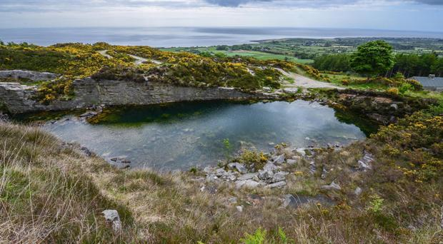 The scene at a disused quarry in Co Down were Kevin O'Hare, 15, and 39-year-old Colin Polland both drowned on Saturday evening