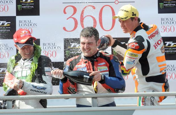 PACEMAKER, BELFAST, 3/6/2013: Michael Dunlop celebrates winning the Superstock TT on his MDR Hondaon the podium today with runner up Gary Johnson (Lincs Lifting Kawasaki) and third placed John McGuinness (HM Plant/ Padgetts Honda). PICTURE BY STEPHEN DAVISON