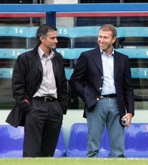 Jose Mourinho (left), pictured with Chelsea owner Roman Abramovich, may have to exercise restraint when it comes to spending money at the club