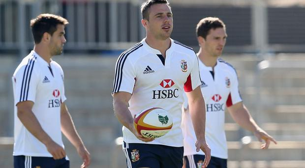 Tommy Bowe holds onto the ball during the British and Irish Lions captain's run at NIB Stadium on June 4, 2013 in Perth, Western Australia. (Photo by David Rogers/Getty Images)