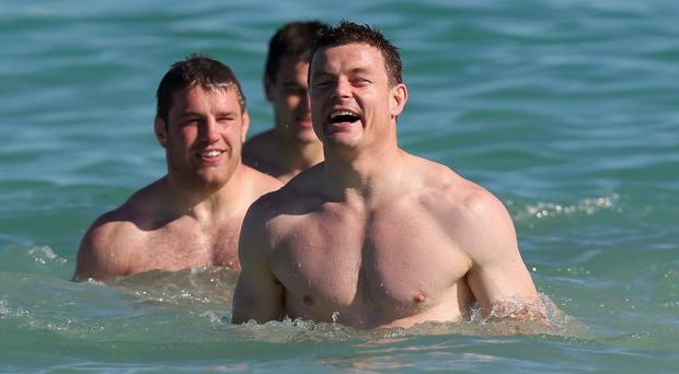 PERTH, AUSTRALIA - JUNE 03: Brian O'Driscoll laughs as he takes a dip in the Ocean during the British and Irish Lions training session held at Langley Park on June 3, 2013 in Perth, Western Australia. (Photo by David Rogers/Getty Images)