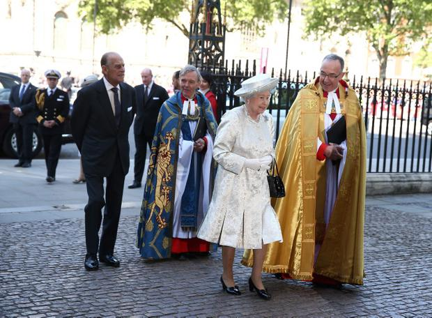 Queen Elizabeth II arrives with Prince Philip, Duke of Edinburgh (L) and Dean of Westminster, The Very Reverend Dr John Hall (R) for a celebration to mark the 60th anniversary of the Coronation Queen Elizabeth II at Westminster Abbey on June 4, 2013 in London, England. The Queen's Coronation took place on June 2, 1953 after a period of mourning for her father King George VI, following her ascension to the throne on February 6, 1952. The event 60 years ago was the first time a coronation was televised for the public. (Photo by Dan Kitwood/Getty Images)
