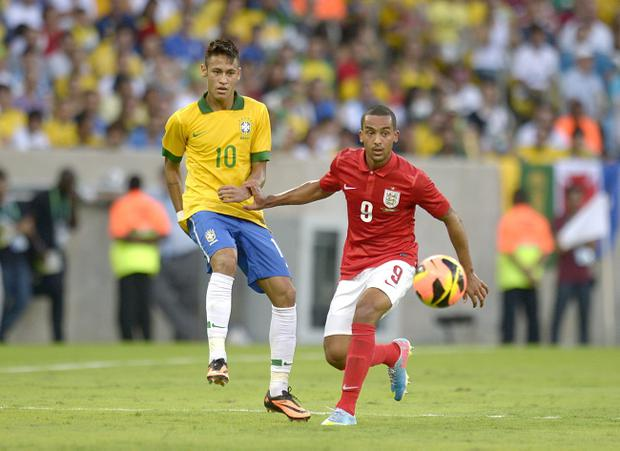 Brazil's Neymar (left) battles England's Theo Walcott at the Maracana Stadium