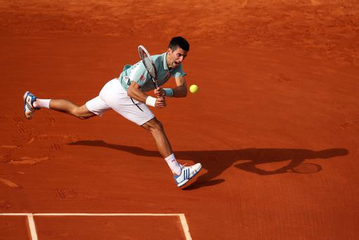 PARIS, FRANCE - JUNE 05: Novak Djokovic of Serbia plays a backhand during his Men's Singles quarter final match against Tommy Haas of Germany on day eleven of the French Open at Roland Garros on June 5, 2013 in Paris, France. (Photo by Clive Brunskill/Getty Images)