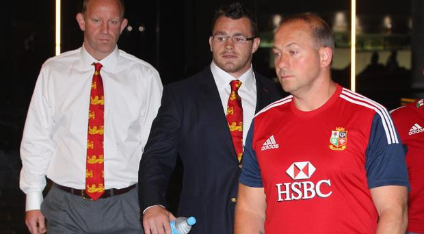 BRISBANE, AUSTRALIA - JUNE 07: Cian Healy (centre) of the British and Irish Lions arrives for the hearing into allegations of biting at the Hilton Hotel on June 7, 2013 in Brisbane, Australia. (Photo by Chris Hyde/Getty Images)