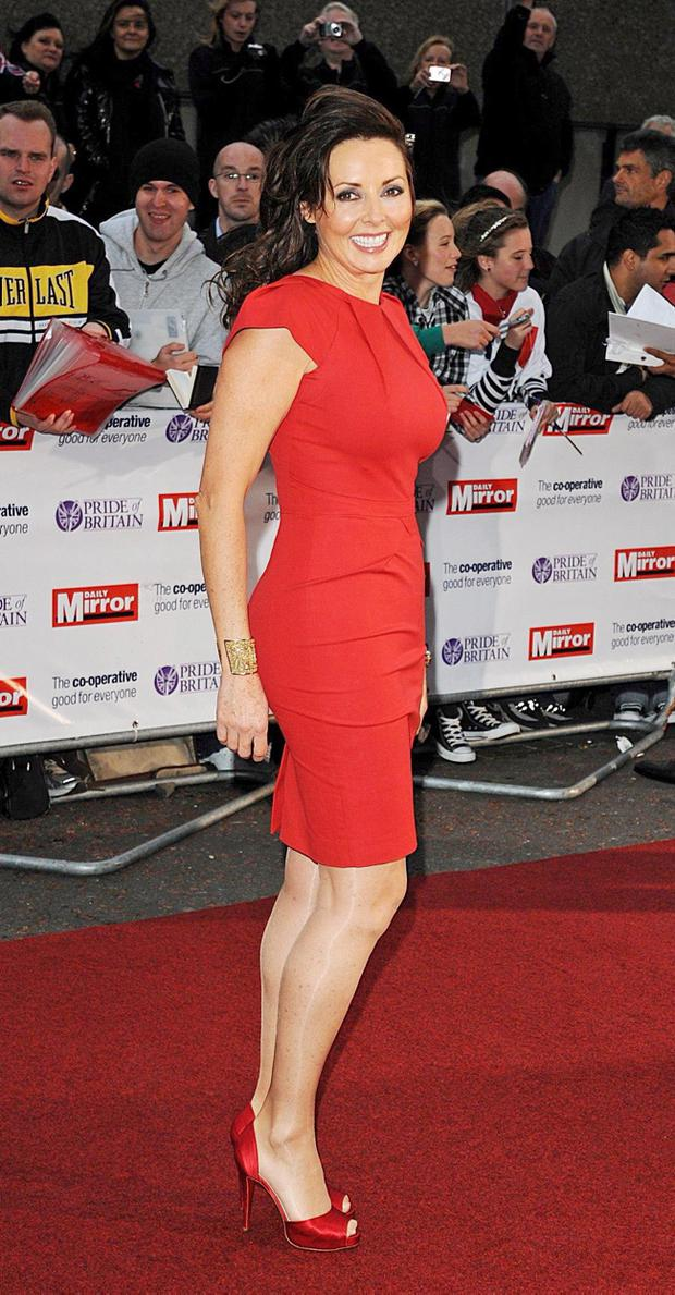Professional sexy person Carol Vorderman recently fell off her heels and broke her beak.