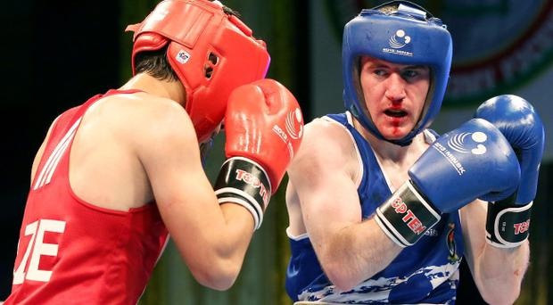 Ireland's Paddy Barnes (blue) in action against Salman Alizada (red) of Azerbaijan. 49kg Light-flyweight Boxing 2013 European Championships, Minsk, Belarus. INPHO/Cathal Noonan