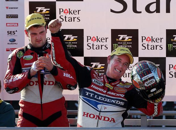 John McGuinness (Honda TT Legends) celebrates winning the PokerStars Senior TT from team mate Michael Dunlop (Honda TT Legends) at IOM TT 2013. Brian Little/ Presseye