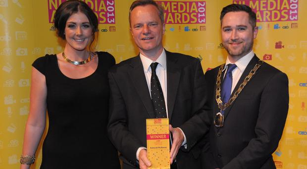 Scoop of the Year collected by Belfast Telegraph Editor Mike Gilson (centre) on behalf of Deborah McAleese, presented by Kelly McKee Morrow Communications and Gary McKeown CIPR