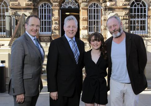 First Minister Rt. Hon Peter D. Robinson MLA has officially launched the HBO Game of Thrones Exhibition which opens to the public at Titanic Belfast. Pictured with the First Minister is Howard Hastings,Chairman NI Tourist Board,actress Maisie Williams and actor Liam Cunningham who attended a tourism event at Crumlin Road Gaol, organised by NITB in partnership with NI Screen. Picture by Brian Thompson/ Press Eye