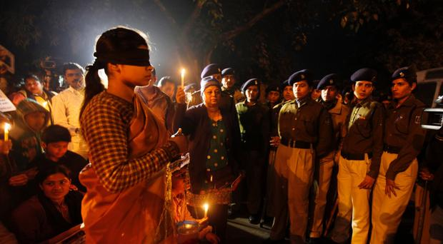There have been widespread protests and candlelit vigils in India after the gang rape of a woman on a bus