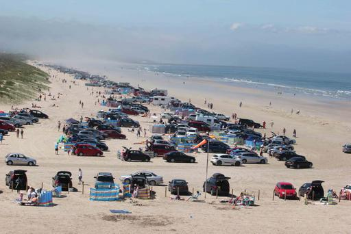 A view of Portstewart Strand Beach as hundreds of cars descend to the beach. Photo by Mark Jamieson