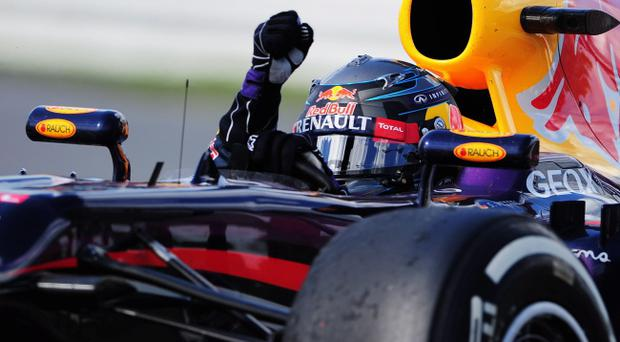 Sebastian Vettel of Germany and Infiniti Red Bull Racing celebrates after winning the Canadian Formula One Grand Prix at the Circuit Gilles Villeneuve on June 9, 2013 in Montreal, Canada. (Photo by Shaun Botterill/Getty Images)