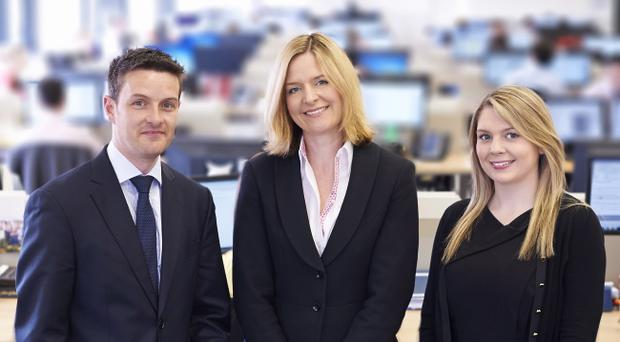 Libby Jackson Belfast director at Herbert Smith Freehills (centre) with team leader Conor Chambers and Respond team member and legal assistant Joan Frazer