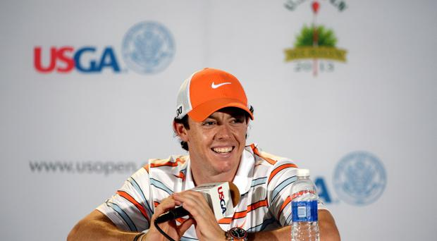 Rory McIlroy of Northern Ireland talks to the media during a press conference prior to the start of the 113th U.S. Open at Merion Golf Club on June 11, 2013 in Ardmore, Pennsylvania. (Photo by Ross Kinnaird/Getty Images)