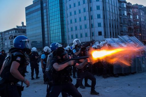ISTANBUL, TURKEY - JUNE 11: Riot police fire tear gas to disperse the crowd during a demonstration near Taksim Square on June 11, 2013 in Istanbul, Turkey. Istanbul has seen protests rage on for days, with two protesters and one police officer killed. What began as a protest over the fate of Taksim Gezi Park has turned, with the heavy-handed response by police, into a protest over what is being seen as Prime Minister Recep Tayyip Erdogan's increasingly authoritarian agenda. (Photo by Lam Yik Fei/Getty Images) *** BESTPIX ***