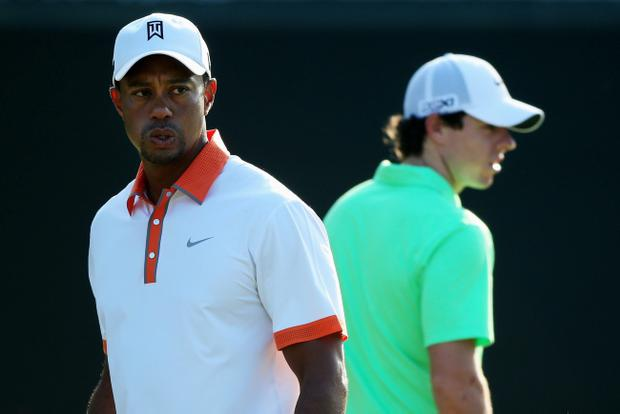 ARDMORE, PA - JUNE 12: (L-R) Tiger Woods of the United States and Rory McIlroy of Northern Ireland walk across a green during a practice round prior to the start of the 113th U.S. Open at Merion Golf Club on June 12, 2013 in Ardmore, Pennsylvania. (Photo by Andrew Redington/Getty Images)