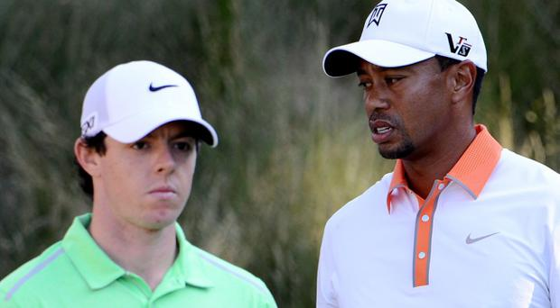ARDMORE, PA - JUNE 12: (L-R) Rory McIlroy of Northern Ireland talks with Tiger Woods of the United States during a practice round prior to the start of the 113th U.S. Open at Merion Golf Club on June 12, 2013 in Ardmore, Pennsylvania. (Photo by David Cannon/Getty Images)