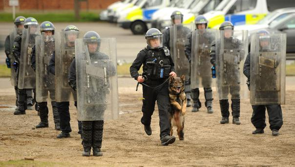 Police officers including members of the PSNI undergo riot training and the use of dogs at Longmoor Army Camp. Andrew Matthews/PA Wire
