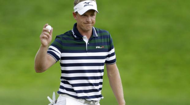 Luke Donald, of England, reacts after a putt on the fourth green during the first round of the U.S. Open golf tournament at Merion Golf Club, Thursday, June 13, 2013, in Ardmore, Pa. (AP Photo/Gene J. Puskar)