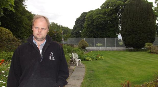 Ryan Johnston, whose view of Lough Erne Resort has been replaced by a metal fence