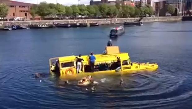 Tourists were rescued or had to swim to safety when the Yellow Duckmarine tour bus sank in Liverpool's Albert Dock.