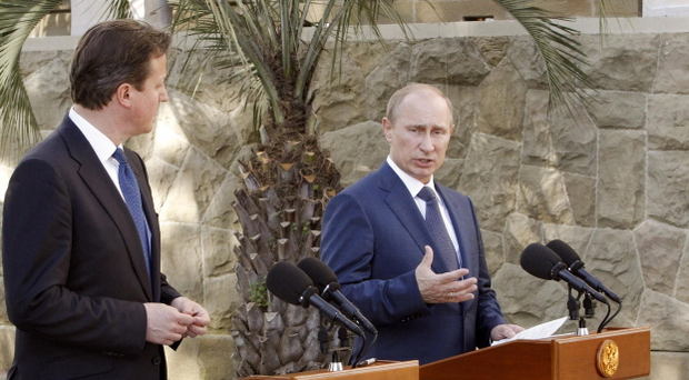 Russian President Vladimir Putin, right, and Britain's Prime Minister David Cameron speak to media after their meeting in the Bocharov Ruchei residence in the Black Sea resort of Sochi, Russia, Friday, May 10, 2013. Britain's Prime Minister met with Russian President Vladimir Putin in the Black Sea resort of Sochi on Friday. David Cameron was expected to press for a political solution to end the continuing violence in Syria. (AP Photo/Sergei Karpukhin, Pool)