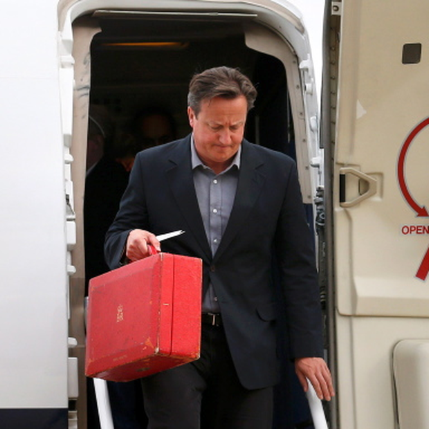 BELFAST, NORTHERN IRELAND - JUNE 16: Britain's Prime Minister David Cameron arrives to attend the Enniskillen G8 summit at Belfast International Airport on June 16, 2013 in Belfast, Northern Ireland. The G8 group of world leaders will meet tomorrow in Fermanagh, Northern Ireland and it's expected that talks will focus on international issues including creating a fairer tax system for the tax paid by corporations.(Photo by Suzanne Plunkett-WPA Pool/Getty Images)