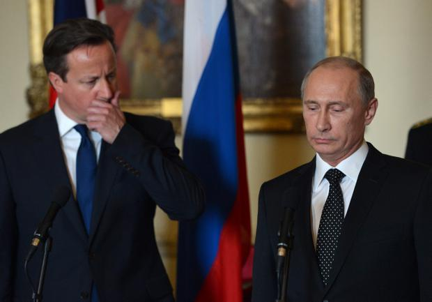 LONDON, UNITED KINGDOM - JUNE 16: British Prime Minister David Cameron (L) and Russian President Vladimir Putin award the Russian Ushakov medal to Artic Convoy Veterans in No 10 Downing street on June 16, 2013 in London, England. Cameron meets with Russian President Putin for talks on the Syrian crisis amid fears that differences between Moscow and the West are pushing the two sides towards a new Cold War. (Photo by Anthony Devlin - Pool / Getty Images)