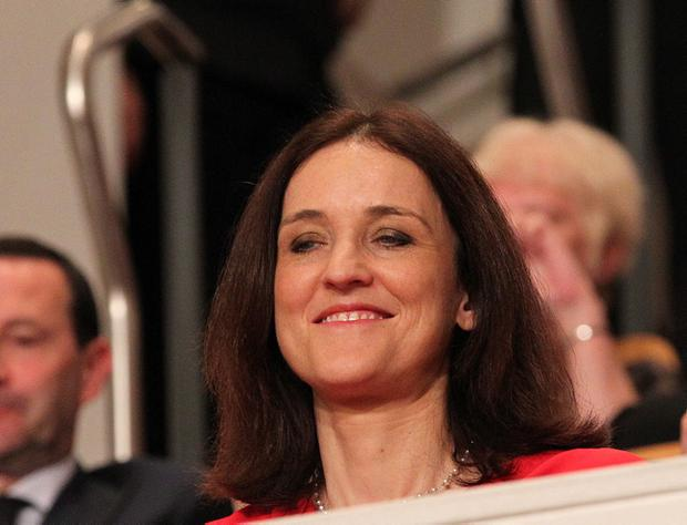 Secretary of State for Northern Ireland Theresa Villiers waiting for US President Barack Obama during his visit to the Waterfront Hall, Belfast ahead of the G8 Summit in County Fermanagh.