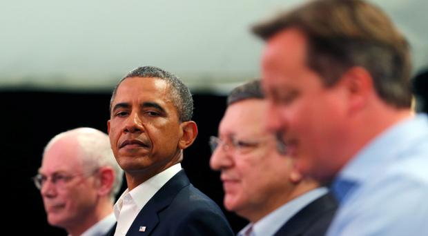 U.S. President Barack Obama glances at Britain's Prime Minister David Cameron during a news conference with European Council President Herman Van Rompuy and European Commission President Jose Manuel Barroso at the G8 summit on June 17, 2013 in Enniskillen, Northern Ireland. (Photo by Andrew Winning - WPA Pool/Getty Images)