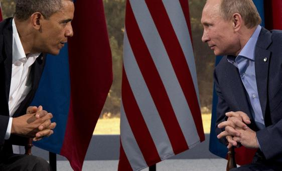 President Barack Obama meets with Russian President Vladimir Putin at the G8 Summit in Enniskillen, Northern Ireland, on Monday, June 17, 2013. Obama and Putin discussed the ongoing conflict in Syria during their bilateral meeting. (AP Photo/Evan Vucci)