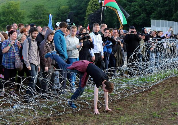 G8 Protesters break through an outer fence during a protest near the G8 summit in Loch Erne, Enniskillen. Paul Faith/PA Wire