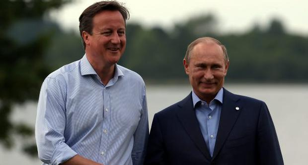 Russian President Vladimir Putin is greeted by Britain's Prime Minister David Cameron (L) at the official arrival of the G8 leaders at the G8 venue of Lough Erne on June 17, 2013 in Enniskillen, Northern Ireland.