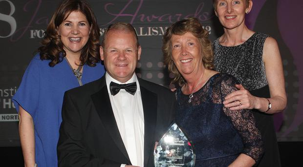 Brain and Hilary Ambrose celebrating his outstanding contribution to industry award with staff from George best airport