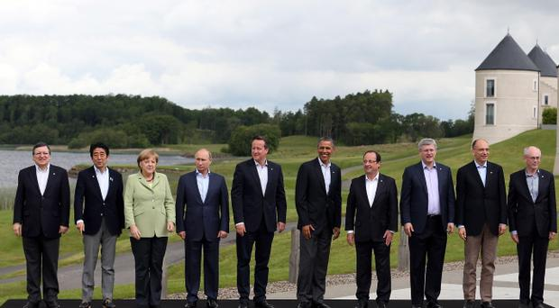 ENNISKILLEN, NORTHERN IRELAND - JUNE 18: Leaders (L-R) President of the European Commission Jose Manuel Barroso, Japanese Prime Minister Shinzo Abe, German Chancellor Angela Merkel, Russia's President Vladimir Putin, Britain's Prime Minister David Cameron, US President Barack Obama, French President Francois Hollande, Canadian Prime Minister Stephen Harper, Italian Prime Minister Enrico Letta and European Council President Herman Van Rumpuy, stand for the 'family' group photograph at the G8 venue of Lough Erne on June 18, 2013 in Enniskillen, Northern Ireland. The two day G8 summit, hosted by UK Prime Minister David Cameron, is being held in Northern Ireland for the first time. Leaders from the G8 nations have gathered to discuss numerous topics with the situation in Syria expected to dominate the talks. (Photo by Matt Cardy/Getty Images)