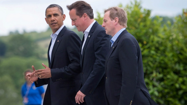 Prime Minister David Cameron walks to lunch with US President Barack Obama and Irish Prime Minister Enda Kenny (right) during the G8 Summit on Lough Erne near Enniskillen