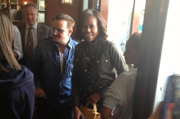 U2 lead singer Bono met US First Lady Michelle Obama and her two daughters for a pub lunch in Dalkey, south of Dublin, during her visit to Ireland on June 18. The singer greets the First Lady at the entrance to Finnegan's Pub. The photos were taken by Irish politician, Mary Mitchell O'Connor.