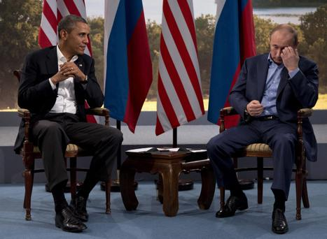 President Barack Obama with Russian President Vladimir Putin at the G8 in Enniskillen, Northern Ireland, Monday, June 17, 2013. Obama and Putin discussed the ongoing conflict in Syria during their bilateral meeting. (AP Photo/Evan Vucci)