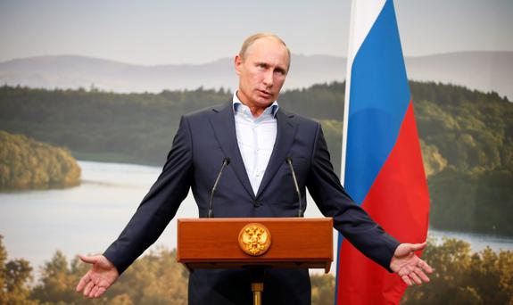 Russian President Vladimir Putin speaks during a media conference after the G8 summit at the Lough Erne golf resort in Enniskillen, Northern Ireland. PRESS ASSOCIATION Photo Matt Dunham/PA Wire