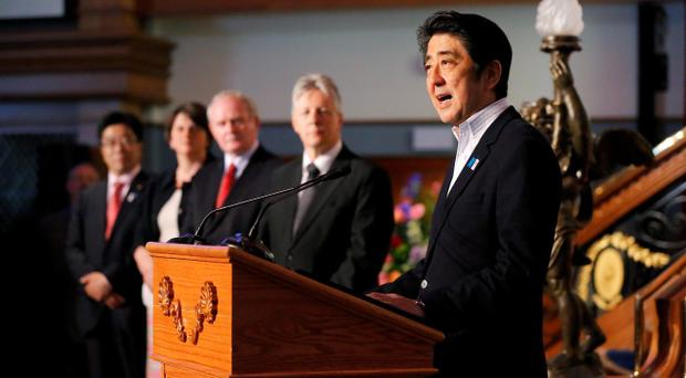 Japanese Prime Minister Shinzo Abe makes a speech during his visit to Titanic Belfast with First Minister Peter Robinson and deputy First Minister Martin McGuinness. Photo by Kelvin Boyes/Press Eye/PA Wire