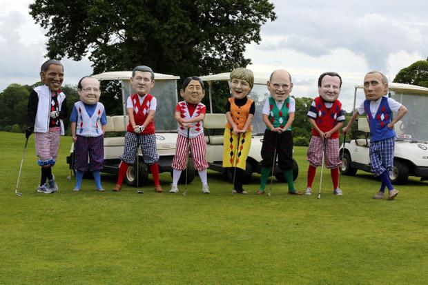 Puppets of US President Barack Obama, French President Francois Hollande, Canadian Prime Minister Stephen Harper, Japanese Prime Minister Shinzo Abe, German Chancellor Angela Merkel, Italian Prime Minister Enrico Letta, Prime Minister David Cameron, and Russian President Vladimir Putin at an IF campaign to highlight world hunger during the G8 Summit at Enniskillen Golf Club, Northern Ireland. Paul Faith/PA Wire