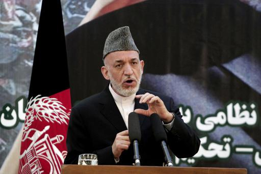 Afghan President Hamid Karzai speaks at a press conference during a ceremony at a military academy on the outskirts of Kabul, Afghanistan, Tuesday, June 18, 2013